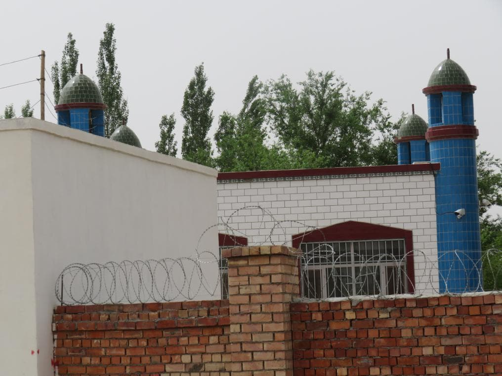 The crescent has been removed from the top of the Juma mosque in Shang Village