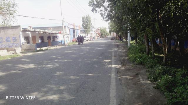 Police on patrol in Ergong village