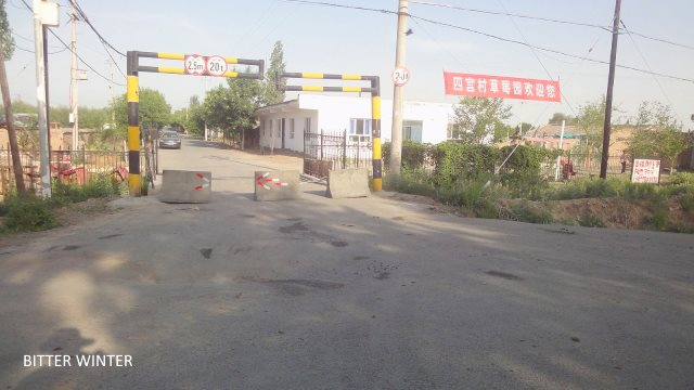 Roadblock at the main junction leading to Ergong Village