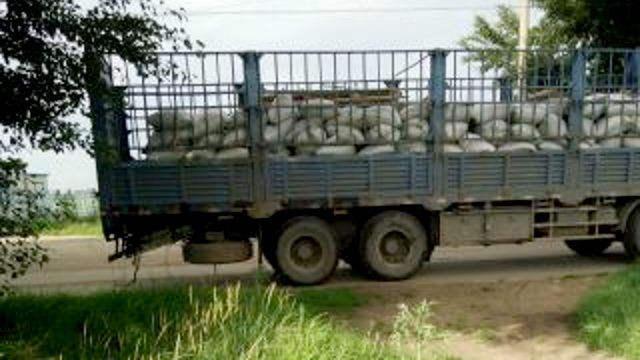 Freight vehicle hauling off Christians' possessions