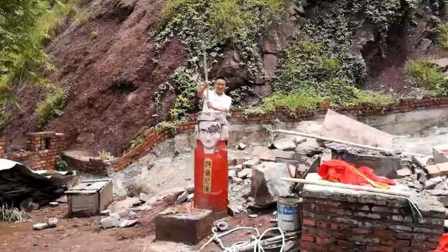 officer smashes Buddha statue