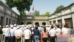 Muslim participate in flag-raising ceremony