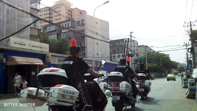 Riot police on motorcycles patrolling the area