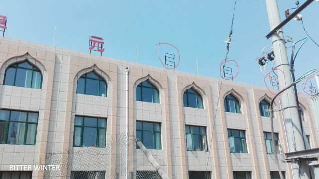 "The words ""Arabic Language"" have already been removed from the top of the teaching block (taken in June of 2018)3"