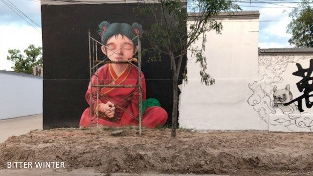 "A mural of a Buddhist nun sitting in meditation has been modified into a ""young girl."""
