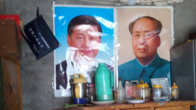 Portraits of Mao Zedong and Xi Jinping were put up instead of religious drawings.