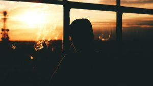 Man looking at sunset (taken from the Internet)