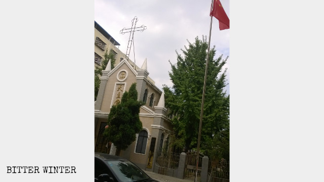 Chinese national flag replaces the cross