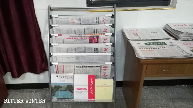 Newspapers are displayed in the church.