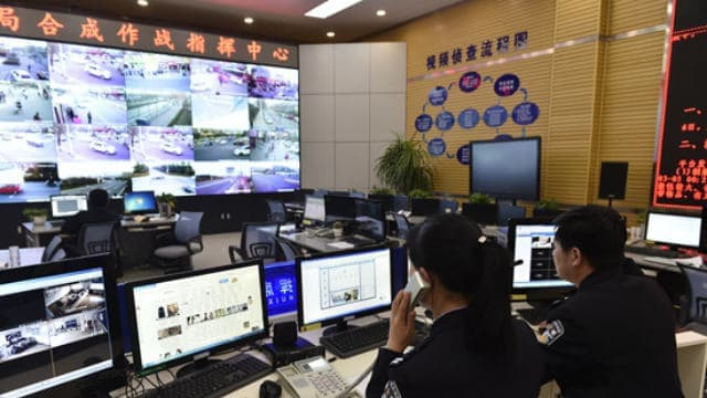 Police watching surveillance monitor