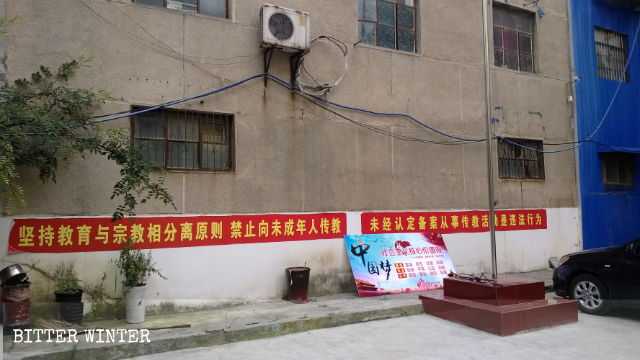 Political slogans are posted on the church's wall