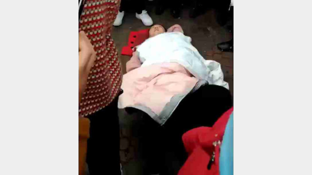 A woman is knocked to the ground.