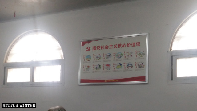 A billboard with propagandist slogans abuts the wall of a State-sanctioned Three Self church in Henan.
