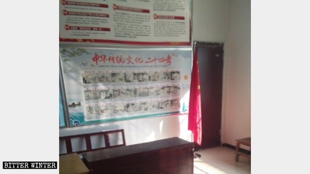 """A poster with pictures of the """"24 Filial Exemplars"""" is on display at Oubeisha Church."""