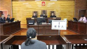Being sentenced for passing out Falun Gong leaflets