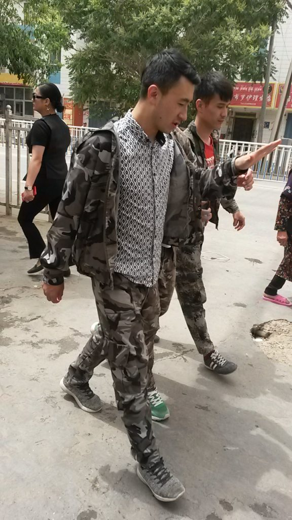 Hotan high school youth are drafted into the internal war on terror, sporting their new military-style summer school uniforms in 2018.