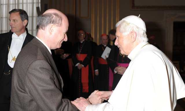 Pope Benedict XVI is congratulating Prof. Introvigne after he lectured at a Vatican-organized conference on the sociological study of the Catholic clergy on November 8, 2012.