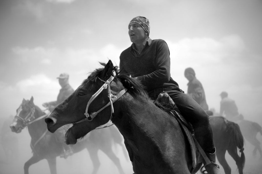 A match of Buzkashi. The equestrian sport is also popular in Afghanistan.