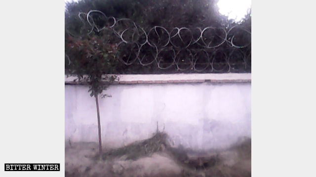 Barbed wire on a perimeter wall surrounding a mosque
