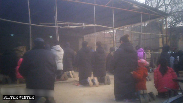 Believers kneel down on the cold ground