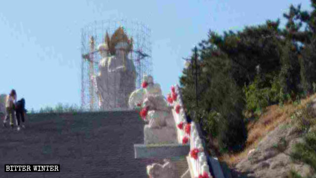 The Buddhist statue at Mount Jiuhua is being wrapped up