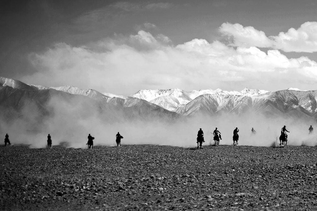 A horde of knights suddenly appears on the horizon in the Karakorum mountain range.