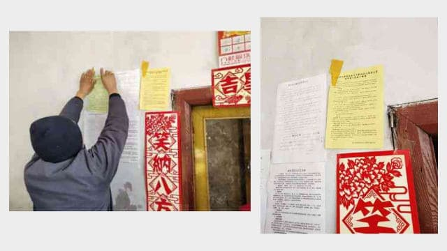 A villager pasting a flyer inciting people to boycott religion.