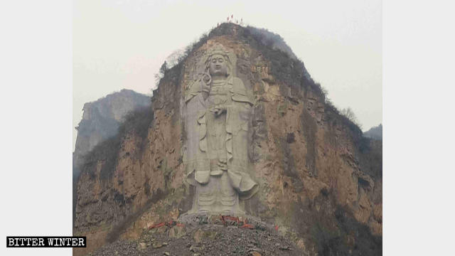Excavators are removing the base of the Guanyin statue