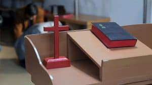 A Bible and a cross on a table of a Chinese house church
