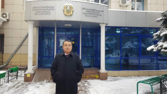 Serikzhan Bilash standing outside of the court