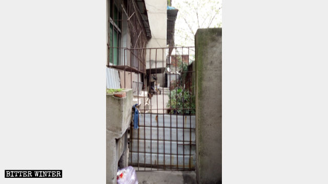 The narrow passageway outside a believer's home