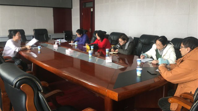 A meeting of teachers on assignment at Xinjiang Radio & Television University.