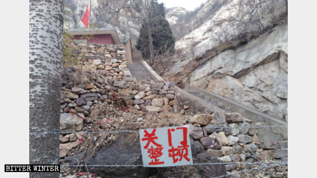The road to Taizi Temple is blocked by barbed wire