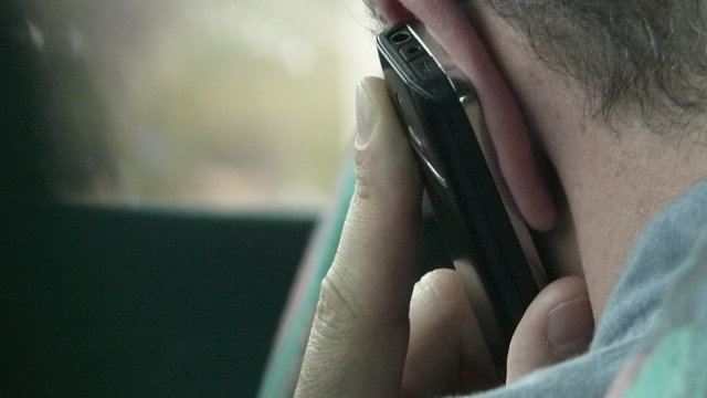 Making a phone call to give secret information
