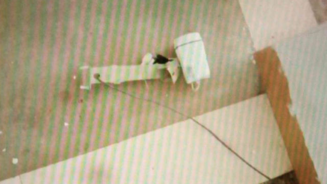 The surveillance camera on the first floor is torn down and thrown on the floor.