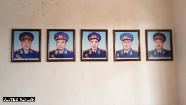 "Photos of the ""Ten Marshals of China"" hang on both sides of the wall."