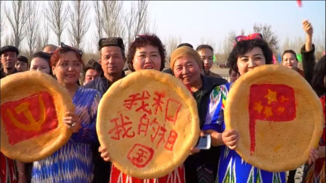 """Uyghur"" ""Nan"" breads ""decorated"" left to right: the CCP hammer and sickle, slogan ""me and my country"" and the Chinese flag, during Spring celebrations in Turpan, Xinjiang."