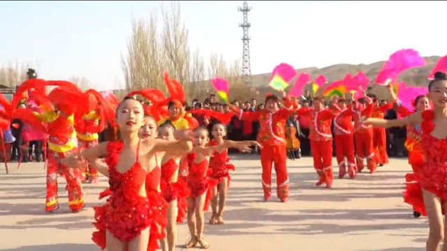 """Young Uyghur girls dressed in """"Chinese style"""" outfits to celebrate the beginning of Spring in Turpan. This infuriates Uyghurs as flouting Uyghur cultural norms."""