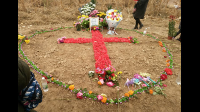Paying homage to Bishop Fan in 2018, churchgoers formed a cross with flowers.