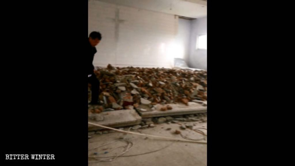 Scene of the dismantled flooring at the podium inside the church