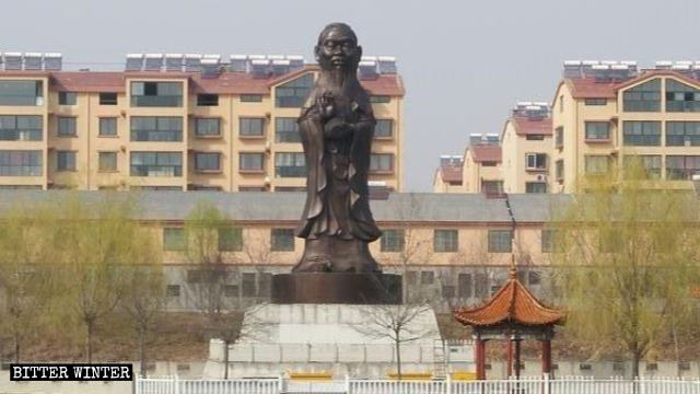 The converted hybrid statue with the body of Guanyin and the head of Confucius