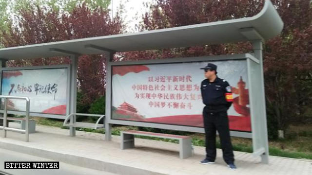 A security officer at the bus stop in Qingdao.