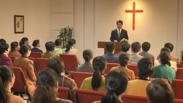 A pastor is telling a sermon in a church