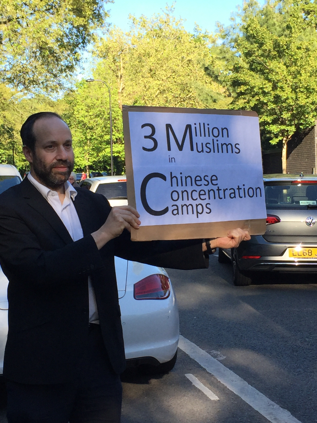 Every week, Andrew holds his placard.