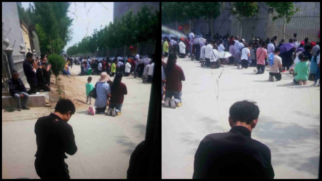 Churchgoers were kneeling and praying on the road outside the pilgrimage site.