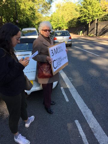 Mrs. Judy Shipton and her granddaughter join the protest.