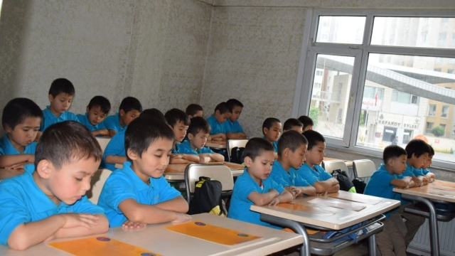 "Uyghur children, most of them ""orphans,"" studying their own language in Istanbul."