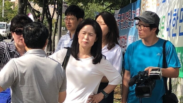 Ms. O during the false demonstration against The Church of Almighty God in Seoul