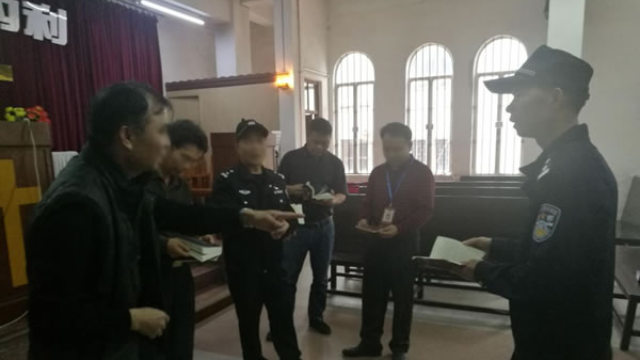 Police officers and Religious Affairs Bureau officials