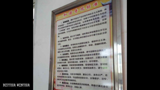 "A ""Standards for a Harmonious Temple"" poster is hung on the wall."
